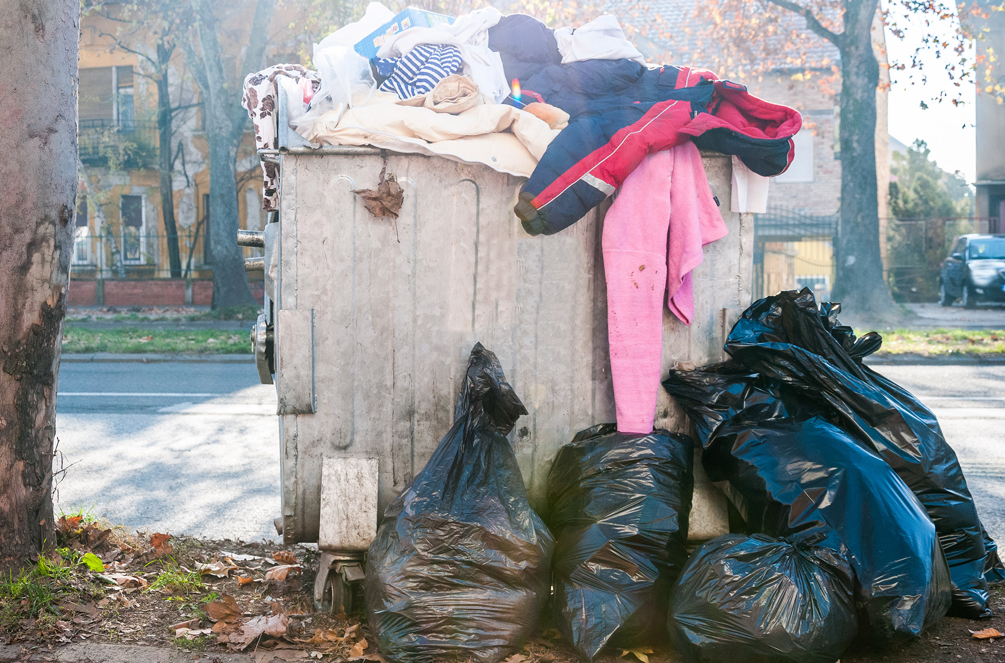 Bags of clothes in trash